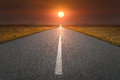 Empty road towards the sun at sunset Royalty Free Stock Photo