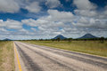 The empty roads of namibia with mount etjo in background Royalty Free Stock Image