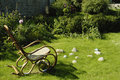 Empty rocking chair on the grass. Stock Photography