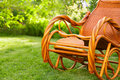 Empty rocking chair over grass at summer sunset Stock Photo