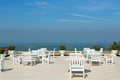 An empty rooftop restaurant with views of the sea Royalty Free Stock Photos