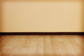 Empty room with clean wall and wooden floor. Royalty Free Stock Photo