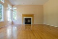 Empty room with fireplace family hardwood floor blank wall residential home interior Royalty Free Stock Photo