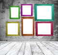 Empty room with multicolored photo frames Royalty Free Stock Photo