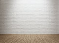 Empty room with spot lit brick wall and copy space Royalty Free Stock Images