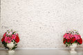 Empty room with white brick wall and beautiful flowers Royalty Free Stock Photo