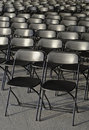 Empty rows of black plastic chairs Royalty Free Stock Photos