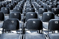 Empty rows of stadium seats simmetrical plastic Stock Photos