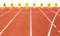 Empty running track with lane numbers on white background Royalty Free Stock Photo