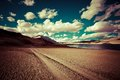 Empty rural road going through desert prairie under sunset sky near tso moriri lake himalaya mountains landscape india ladakh Royalty Free Stock Photos