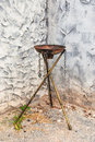 Empty rusty steel fire torch on brass stand brasslstand Stock Images