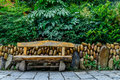Empty seat in the park and rock wall Royalty Free Stock Images
