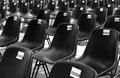 Empty seats black and white picture with multiple Royalty Free Stock Photo