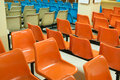 Empty seats orange white and blue Royalty Free Stock Photos