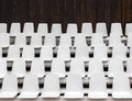 Empty seats white in an outdoor venue Royalty Free Stock Image