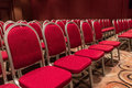 Empty seminar conference room with rows of red seats Royalty Free Stock Photo