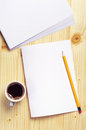 Empty sheet of paper and coffee cup on wooden table top view Royalty Free Stock Image