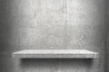 Empty shelves top Ready for product display montage; cement shelves and gray cement background.. Royalty Free Stock Photo