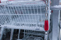 Empty shopping cart with coin lock and snow on it Stock Photography