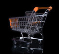 Empty shopping cart isolated in black orange from behind Royalty Free Stock Photos