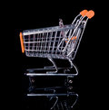Empty shopping cart isolated in black orange from side view Stock Photo