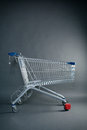 Empty shopping cart studio photo of an supermarket on a dark background Royalty Free Stock Photography