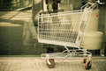 Empty shopping cart trolley outdoor market shop and retail grocery concept sepia one Stock Images