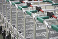 Empty shopping carts linked together closeup of Stock Photography