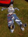 Empty silver protective coveralls for fireman ready on ground Royalty Free Stock Photography