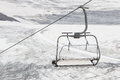 Empty ski lift above snow Royalty Free Stock Photo