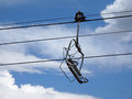 Empty ski lift during the summer with clouds in sky Royalty Free Stock Photo