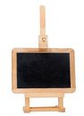 Empty small blackboard on a easel isolated on white background. Royalty Free Stock Photos