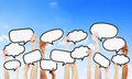 Empty speech bubbles raised and more copy space above Royalty Free Stock Photos