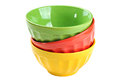 Empty, stacked, colored bowls (red, yellow, green), isolated on Royalty Free Stock Photo