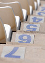 Empty stadium chairs white and row numbers Royalty Free Stock Photography