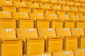 Empty stadium grandstands red seats plastic chairs in a Royalty Free Stock Photo