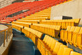 Empty stadium grandstands seats plastic chairs in a Royalty Free Stock Photos