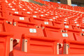 Empty stadium grandstands seats plastic chairs in a Royalty Free Stock Image