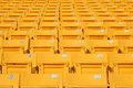 Empty stadium grandstands seats plastic chairs in a Royalty Free Stock Photo