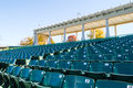 Empty stadium seating in large amphitheater many rows of a outdoor Stock Image