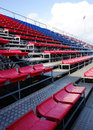 Empty stadium seats red and blue at a small or sports arena Stock Images