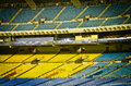 Empty stadium yellow blue seats nobody Royalty Free Stock Photography