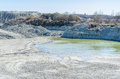 Empty stone pit big with water Royalty Free Stock Photography