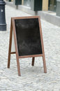 Empty street restaurant menu blackboard an Royalty Free Stock Image