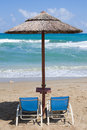 Empty sunbeds at tropical beach image of Stock Photography