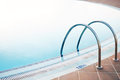 Empty swimming pool silver handles in holiday resort. Royalty Free Stock Photo