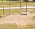 Empty swing on children playground in city Royalty Free Stock Images