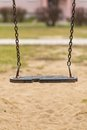 Empty swing on children playground in city Stock Images