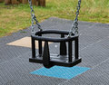 Empty swing seat in a park Royalty Free Stock Photos