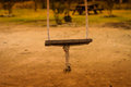 Empty swing simple made of rope and a wood plank in a local park of a small village in marmara region of the country turkey Royalty Free Stock Photography